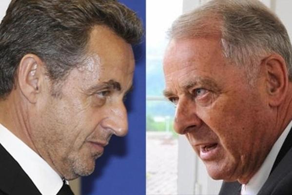Nicolas Sarkozy et Adolf Ogi, l'ancien Président suisse.