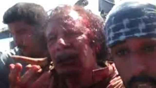 Le colonel Kadhafi entre les mains des mercenaires de l'OTAN.